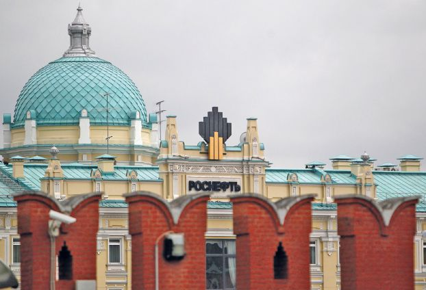 File photo of the logo of Russia's top crude producer Rosneft seen at the company's headquarters, behind the Kremlin wall, in central Moscow