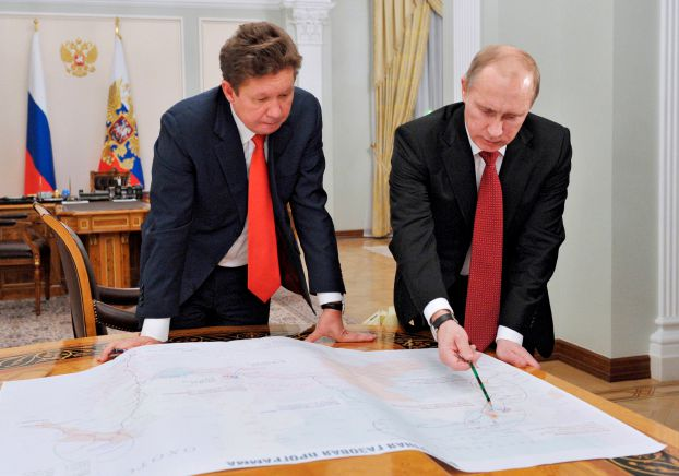 File photo of Russia's President Putin meeting with Gazprom's Chief Executive Miller at the Novo-Ogaryovo residence outside Moscow